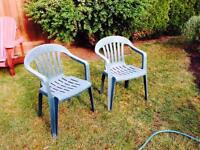 2 Plastic Stackable Chairs