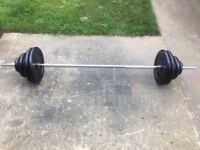 SOLID BARBELL WITH 65KG OF YORK CAST IRON WEIGHTS