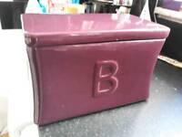 Purple ceramic bread bin