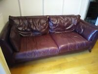 FREE leather sofa in blackberry colour, 3 seater, has a rip