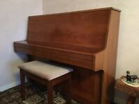 Upright Bell piano with high gloss finish