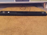 LG 100 watts Soundbar with Built-in Subwoofer