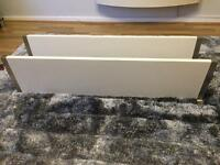 2 heavy weight white wooden shelves with silver brackets.