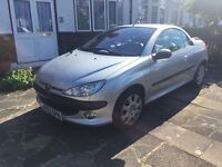 Peugeot 206CC unmarked leather interior, lots of history