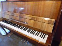 modern upright piano by lirika