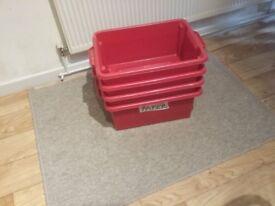 4 stackable plastic storage boxes