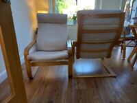 Two Ikea Poang chairs.