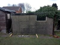 Concrete panel shed free to anyone with the know-how to dismantle and remove it.