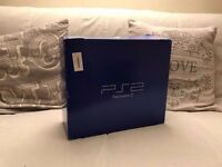 Boxed PS2 with 2 controllers and instructions