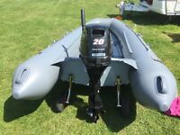 Folding rib boat and outboard engine