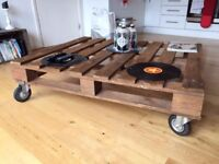 Hand made coffee table from recycled pallet wood with wheels.