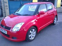 SUZUKI SWIFT. 1.2 PETROL GL. 5 DOOR. RED. 09 REG.