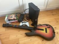 Xbox 360 with 6 free games including guitar hero