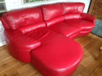 Lovely red leather sofa and reclining chair suite.