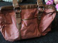 Babymel red stripe changing bag