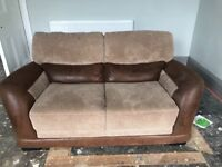 Brown material and faux leather effect 2 seater and 4 seater sofa with foot stall