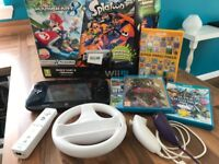 Wii u and accessories, boxed with selection of games