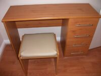 Pine effect dressing table with 4 drawers and matching stool . Excellent condition . Smoke free home