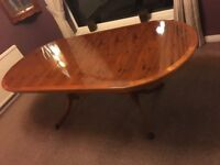 Beautiful Yew wooden extendable dining table and 6 chairs