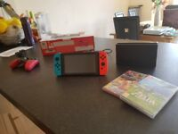 Nintendo switch with Mario Kart and Zelda BOTW + Pro Controller +more