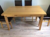 Extendable oak dining table with 6 brown leather chairs