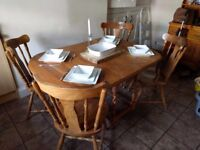 Teak Antique dining table with four chairs. Must see. Extendable and attractive.