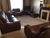 Leather sofas, chair and footstool