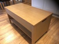 Coffee table oak colour with sliding top opening storage (two block) and shelf