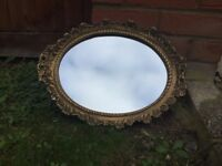 Oval gold ornate mirror