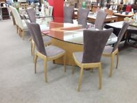 Large Unique Glass Oval Dining Table and 8 Fabric Chairs