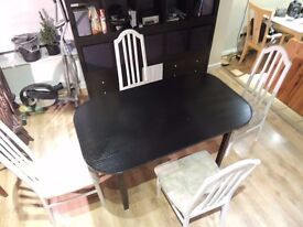 Black table and 4 white chairs