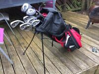 Wilson golf bag with set of Howson clubs, including driver and 3 wood