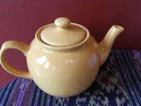 Cute yellow ceramic teapot