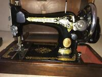 Antique vintage singer sewing machine. Lovely condition. In box & wooden base. Hand crank