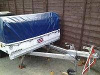 trailer tent with large awning