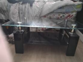 Glass table with black base