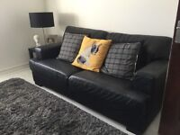 Black Leather Sofas and matching Footstool