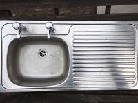 Stainless steal sink with taps and pipes