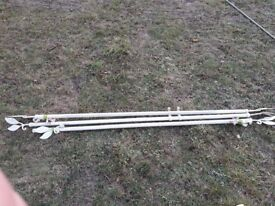 Cream metal curtain poles with leaf finials - good condition