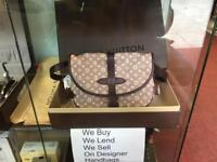 Louis Vuitton handbag with receipts and paperwork