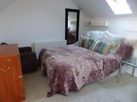 large double room ensuite with lounge area in a family home. Single person only, all bills inc.