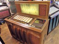 Vintage Rock Ola Jukebox, plays vinyl 45s, set to free play n fully working.