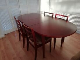 Dining table and four newly cushioned and upholstered chairs.