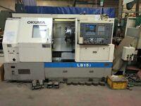 OKUMA MODEL LB 15 2 CNC 2 AXIS LATHE YEAR 1994