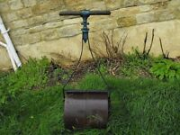 Antique garden roller cast iron self righting twin rollers