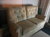 2 seater sofa with drop down arms. In very good condition.