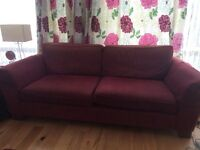 Two M&S sofas in Cranberry, chair and two pair matching full length curtains and floor rug £350