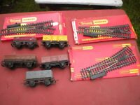 5 OLD TRI- ANG RAILWAY TRUCKS AND 3 SETS OF POINTS