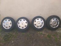 * * * * 4x Vauxhall Corsa wheels & tyres 165/65r14 & Hub caps * * * *