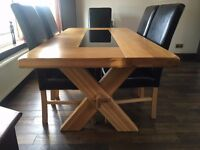 Modern Solid Oak Dining Table with 6 matching Leather Covered Dining Chairs